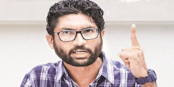 Mevani burns a bill's copy, urges tribal MLAs to join protest