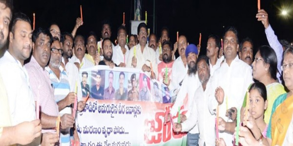 TDP workers take out candlelight rally