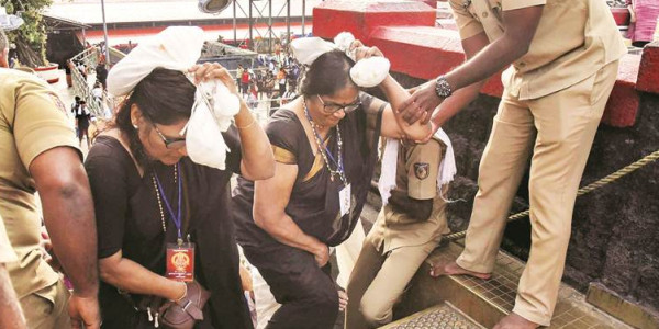 Sabarimala temple row: Devotees try to block woman from entering, case against 200 people