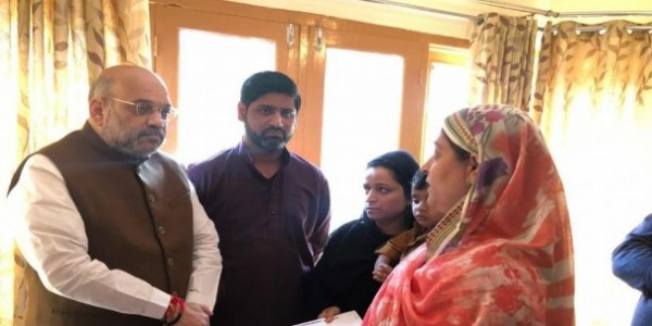 Amit Shah lauds J&K cops, hands over appointment letter to Anantnag martyr Arshad Khan's wife