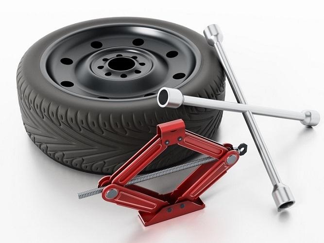 Motorist Changing Flat Tire 9