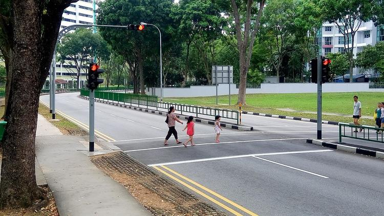people crossing the road singapore