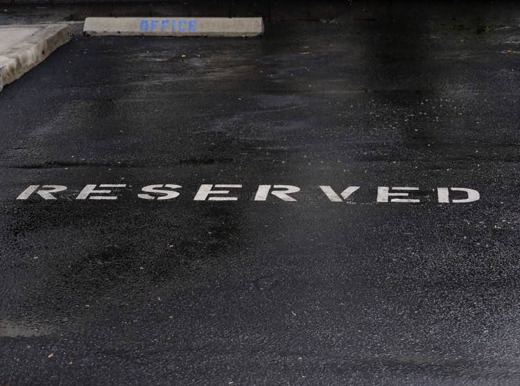 Rain Soaked Reserved Parking Spot