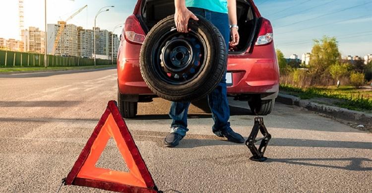 Motorist Changing Flat Tire 2