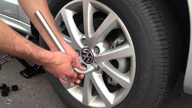 Motorist Changing Flat Tire 3