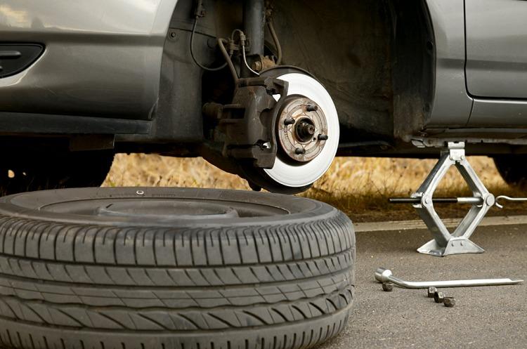 Motorist Changing Flat Tire 5
