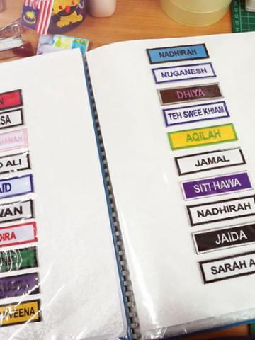 Photo 1 of TANDA NAMA SEKOLAH TP-499002 TANDA NAMA SEKOLAH warna kain & benang boleh dipilih.  Tiada minimum order dan kami juga terima tempahan pukal.