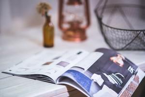 Reading magazine open newspaper
