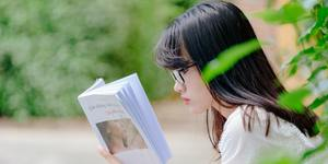 Selective focus photo of woman reading book 1313809