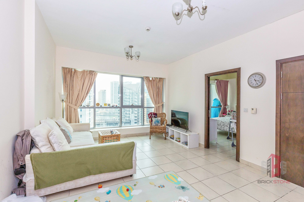 Furnished 1BR Partial Marina view next to the Tram