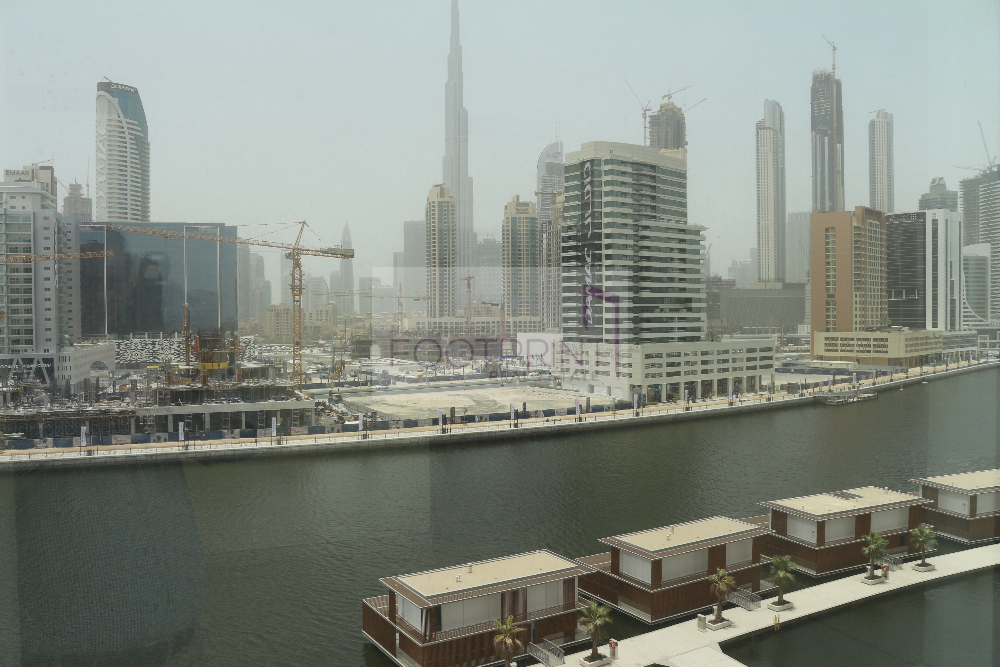 Apartment  with  view of canal and burj.