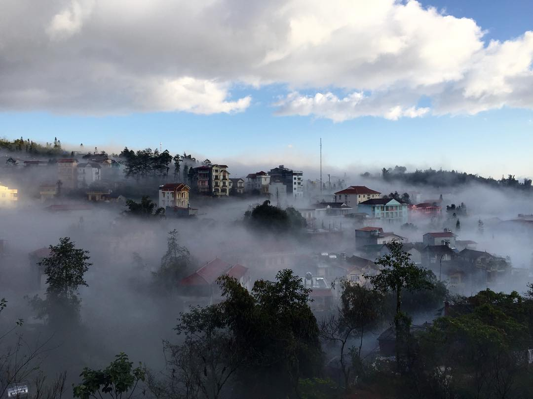 Sapa town immersed in sea fog.