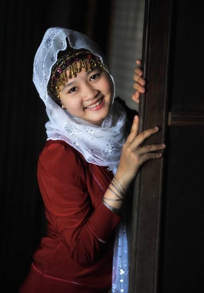 Cô gái Chăm với nụ cười hiền - Ảnh: Huynh Phuc Hau