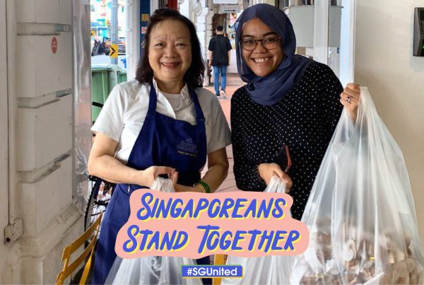 Singaporeans of different races doing social work