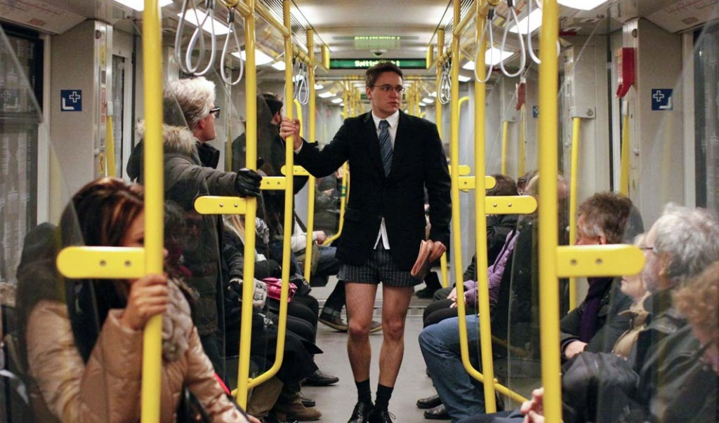 """Passengers look at a man without his pants on the subway during the """"No Pants Subway Ride"""" in Berlin January 13, 2013. The event, organised by Improv Everywhere, involves participants who strip down to their underwear as they go about their normal routine. REUTERS/Fabrizio Bensch (GERMANY - Tags: SOCIETY) ORG XMIT: FAB03"""