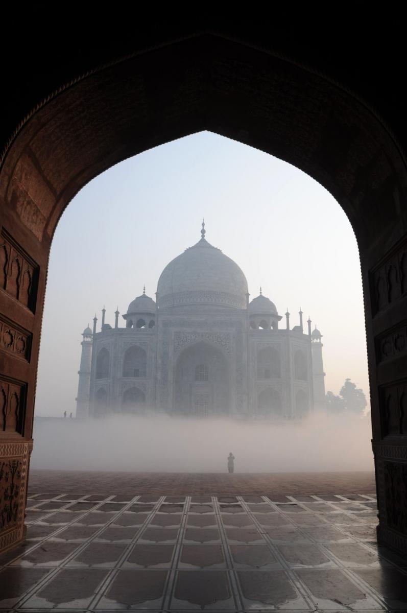 Taj_Mahal_through_the_early_morning_mist,_Agra.jpg