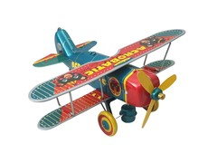 Old-school Tin Toy Acrobatic Bear Plane