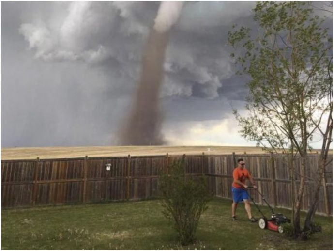 Canada, tornado, alberta, calgary, storm, internet, twitter, sky, weather, thunderstorms, Man cuts Grass In Massive Tornado, Man Mows Grass In Massive Tornado, Man Cuts Grass In Massive Tornado