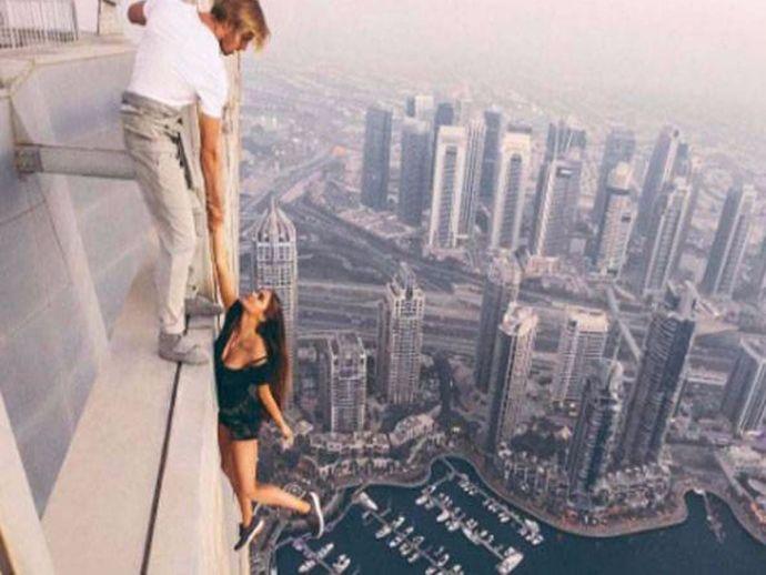 Russian Modal, Dangles, followers, Dubai skyscraper, Viki Odintcova, Russian model stunt, Model Hanging On Skyscraper, model hangs from building