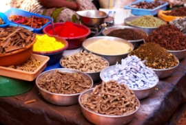 herbs and spices on a wooden table in India