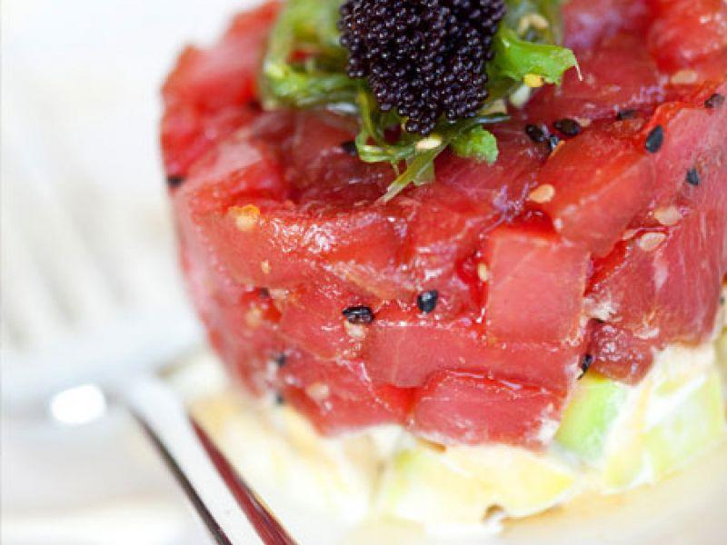 Tuna tartar in sesame oil with avocado balsamic and wasabi dressing