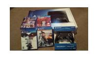 Sony PlayStation 4 +2 Wireless controller + Camera + 5 Games $300usd