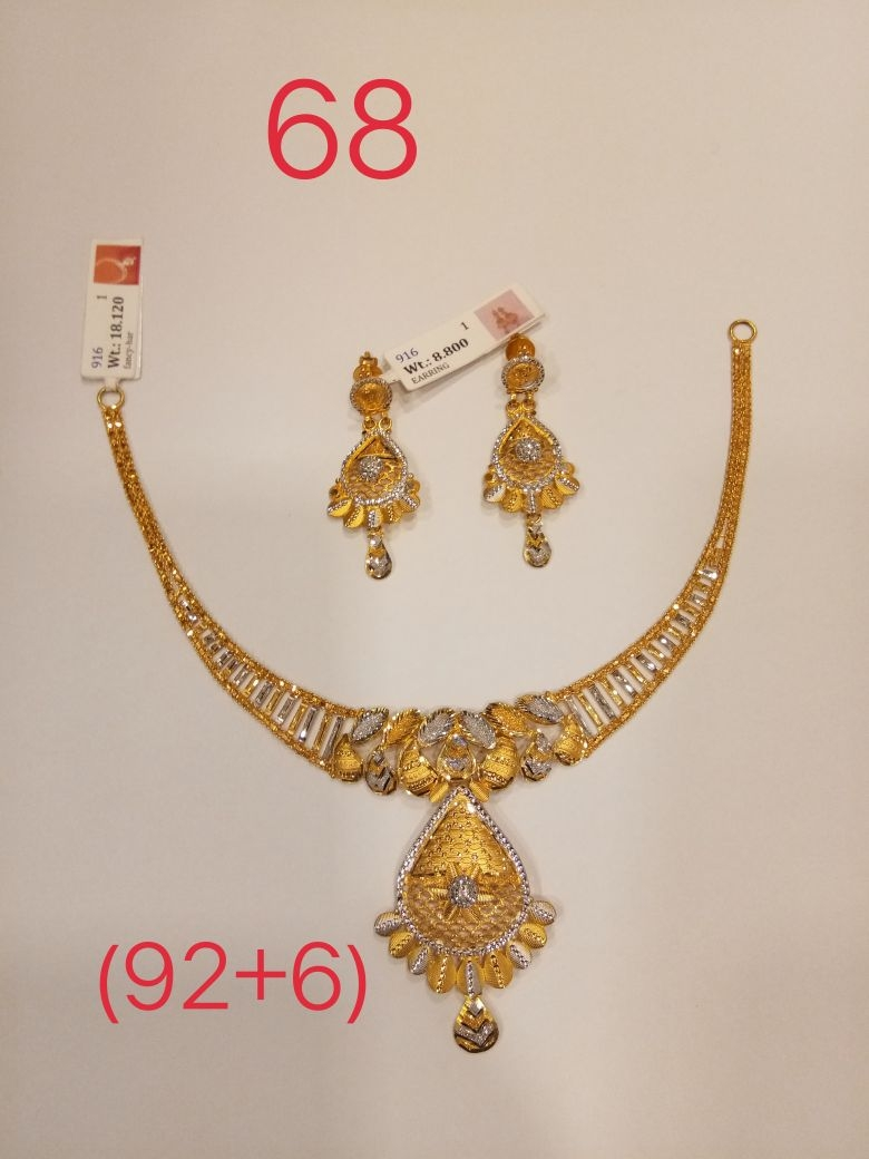 Weight. Har 18.120gm Earing 8.800 916 Hallmark