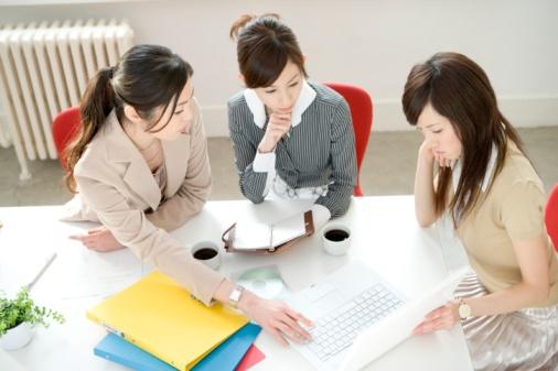 Three women having meeting at desk