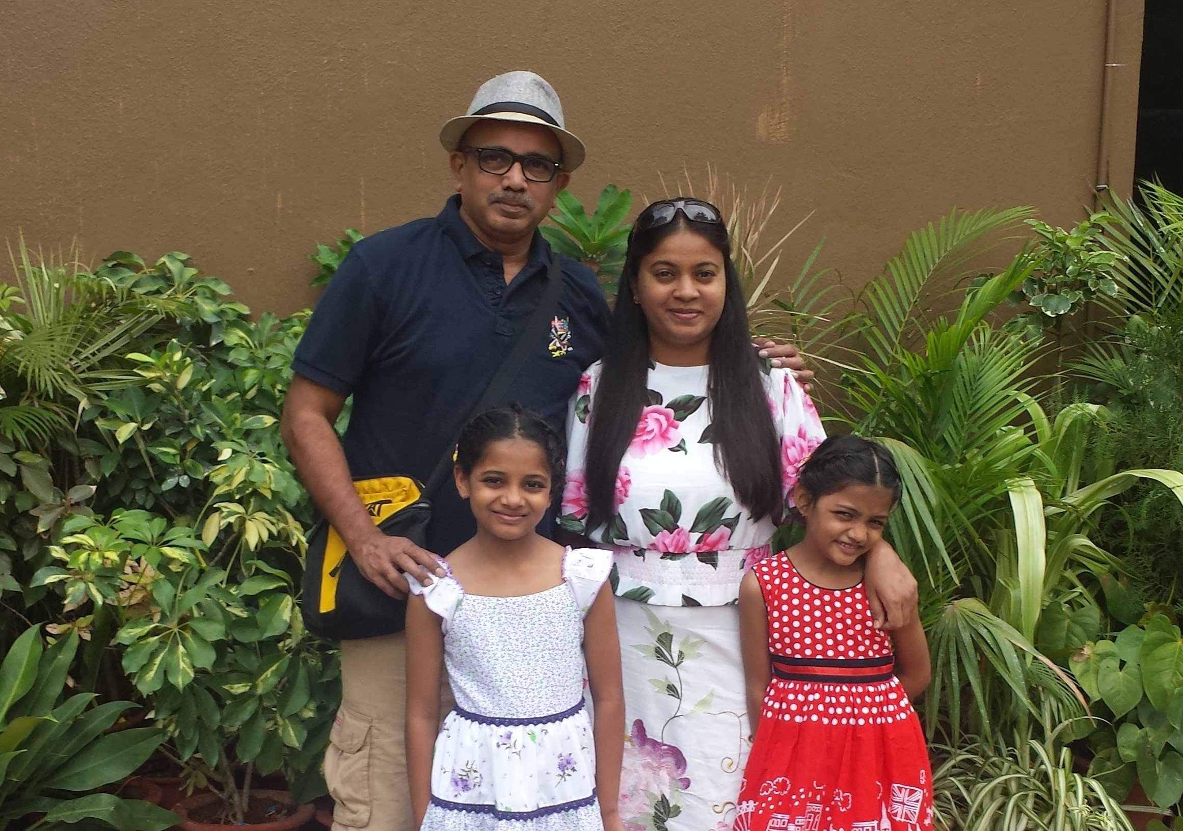 Meenal Mungekar With Her Husband And Daughters