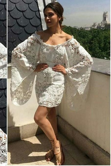 aeedb205a805 Deepika s white bell sleeves lace crochet off shoulder dress along with  brown tie up sandals