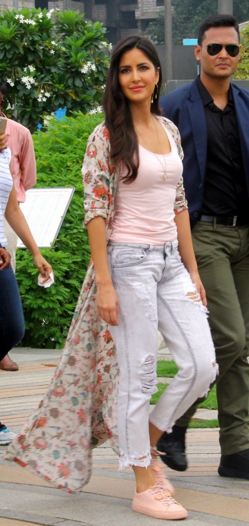 Obsessing over her casual effortless look! Want the long floral cape only! - SeenIt