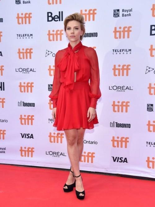 Scarlett Johansson in a tie-neck long sleeve Sybil dress at Sing premiere. - SeenIt