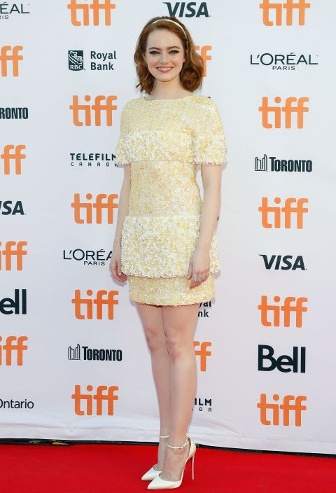 Emma Stone looks lovely in a yellow Chanel dress at the