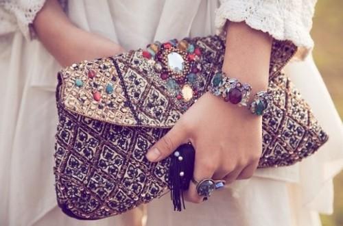 Find me a similar heavy embellished clutch. - SeenIt