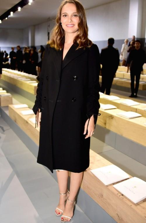 The face of Miss Dior fragrance, Natalie Portman, clads her bump in a double-breasted coat. - SeenIt