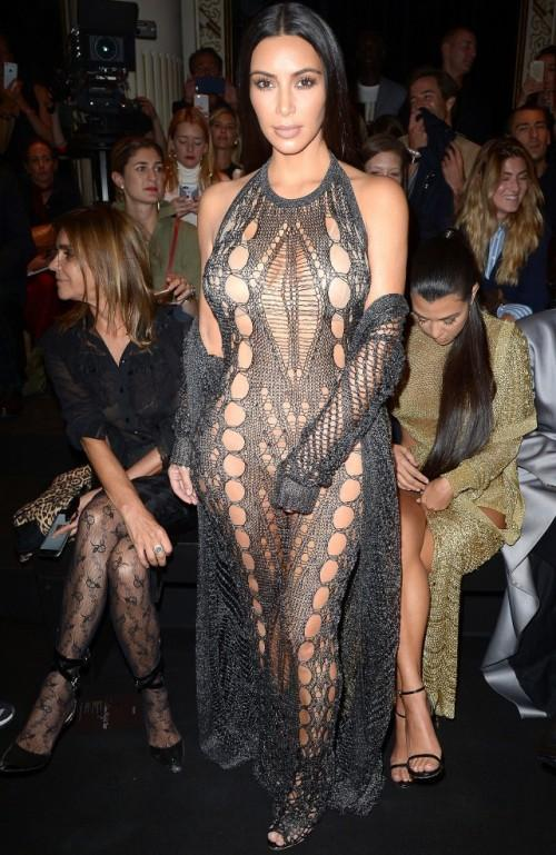 KIm ia a true risk-taker to attempt a totally see-through macramé catsuit. - SeenIt