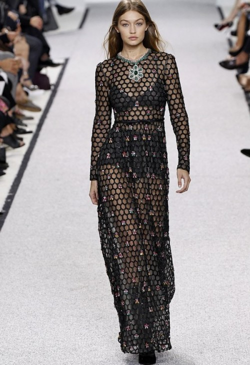 Gigi closed the Giambattista Valli show in a daring black mesh gown. - SeenIt