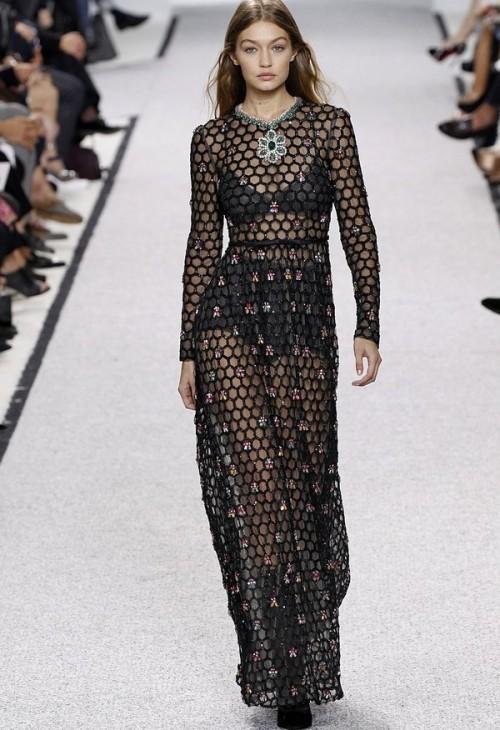 Gigi closed the Giambattista Valli show in a daring black mesh gown. - SeenIt
