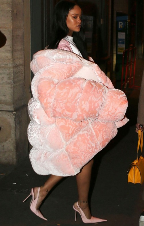Rihanna can wear anything, including this giant Ella Boucht baby pink coat that she carried. - SeenIt
