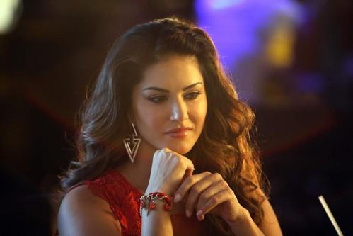 This golden triangle shape earrings that Sunny Leone is wearing in the movie Beiimaan Love. - SeenIt
