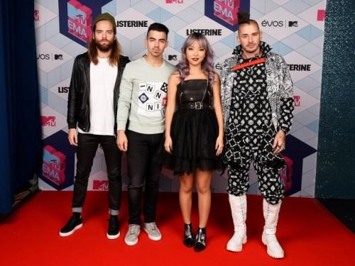 The band DNCE at the EMA Awards. - SeenIt