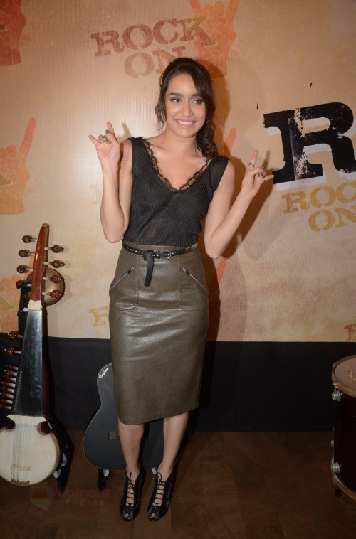 Can you help me get this entire look of shraddha's , the deep neckline lacy top with a high waisted leather knee length skirt and those lace up heels.. - SeenIt