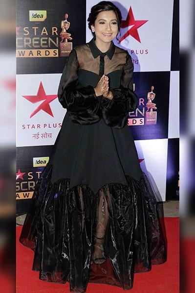 Gauhar Khan in black Avaro Figlio shirt style gown at the Star Screen Awards 2016. - SeenIt