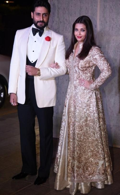 Complementing each other! Abhishek and Aishwarya at Manish's B'day Bash. - SeenIt