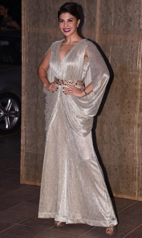 Jacqueline in a shimmer gown at Manish's Birthday Bash. She nailed the look completely! - SeenIt