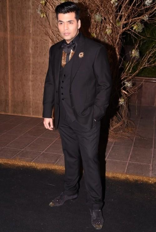 Karan follows his own style! He attended Manish's B'day Bash in a very stylish ensemble. - SeenIt