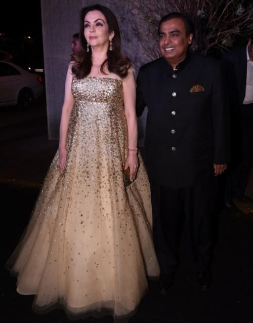 Nita with Mukesh Ambani at Manish's B'day Bash. She looked like a fairy in this sequin gown! - SeenIt