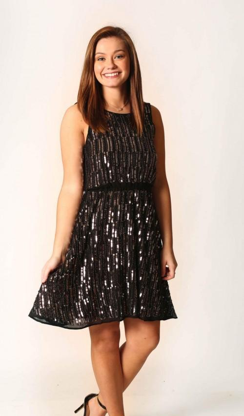 A black sleeveless sequin party dress.. - SeenIt