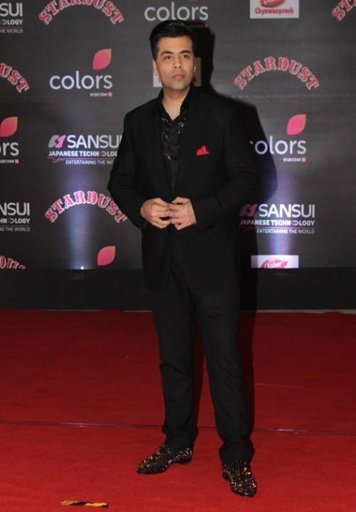 Karan Johar in a black outfit paired with studded shoes at the Stardust Awards 2016. - SeenIt