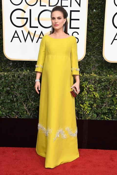 Natalie Portman in a yellow Prada gown at the Golden Globe Awards 2017. - SeenIt